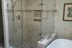 Frameless-Shower-Door-with-Inline-Panel-and-Return